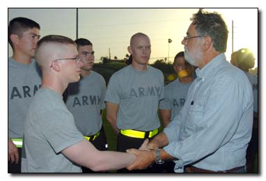 "Gordon Haberman, who lost his daughter at the World Trade Center on Sept. 11, 2001, talked about his daughter to the soldiers of the 189th Military Police Co. at U.S. Naval Station Guantanamo Bay, July 15, 2009, and thanked them for their service to Joint Task Force Guantanamo. Haberman was part of a group of Sept. 11, 2001, victim family members who asked to meet the JTF guards – just to say, ""thank you"" -- when the group was here for the recent military commissions proceedings."
